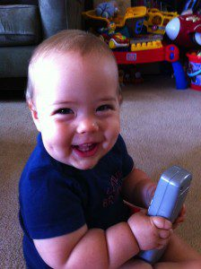 He's still young enough to accept the toy remote...occasionally!