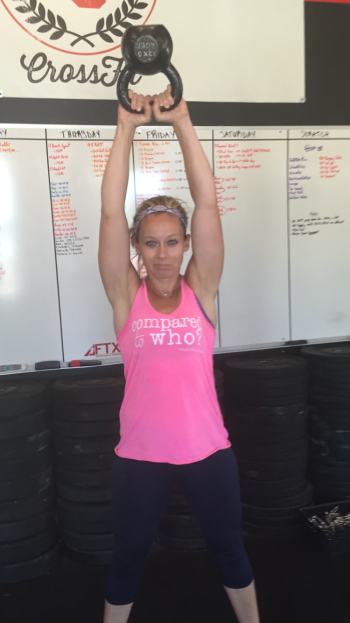 "Crossfit's infamous kettle bell swings! Here's my friend Lindsey doing some in her ""Compared to Who"" shirt!"