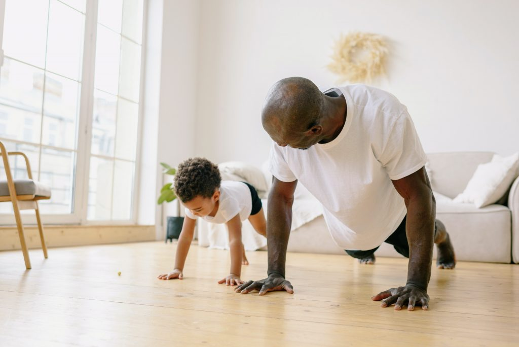 father and son working out how to help son with body image Christian